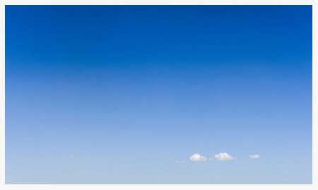 Tiny clouds in a vast blue sky …